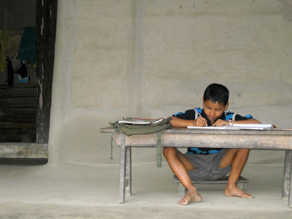 Child Studying in Rural Assam